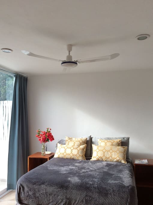 Ceiling fan and AC unit in the bedroom for your confort.
