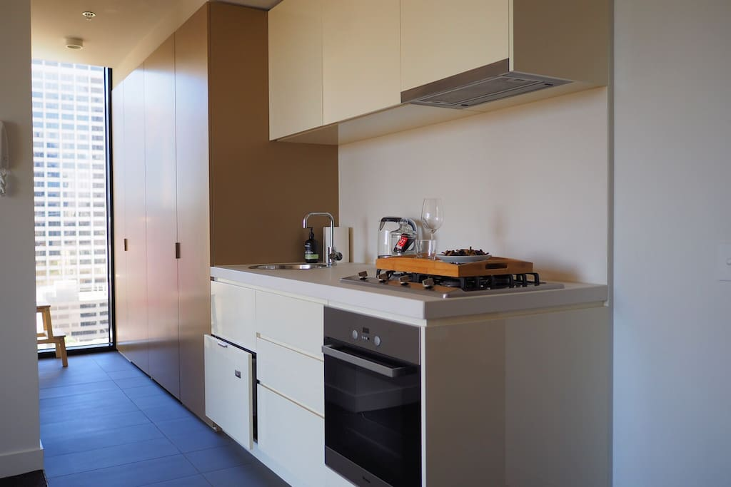 Fully equipped open-plan kitchen with plenty of light. (Miele gas-top stove, Miele oven, microwave, dishwasher, Nespresso machine and kettle)