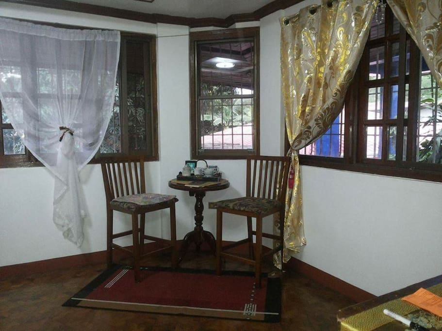A coffee table by the window where morning breeze from the nearby trees gives you a fresh scent of the mango tree...it provides shades also to the scorching heat of the sun