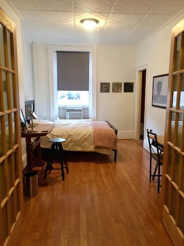 bedroom with 2 desks, walk-in closet