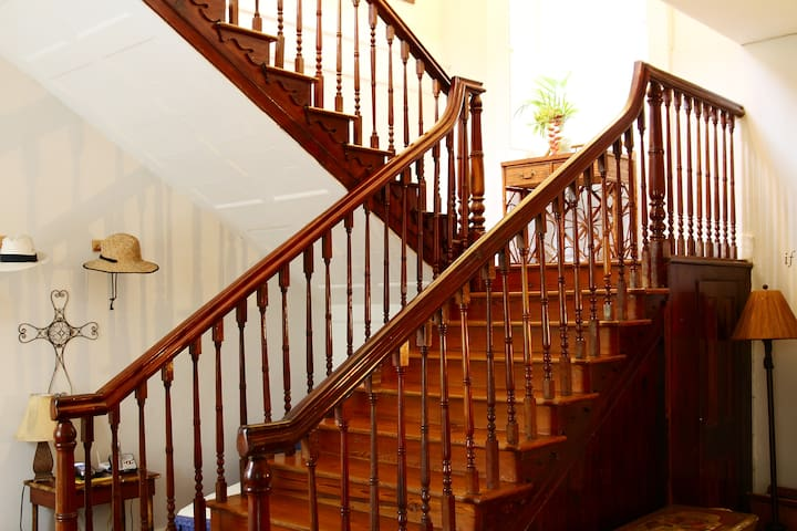 Gorgeous mahogany staircase leading up to The Island Room