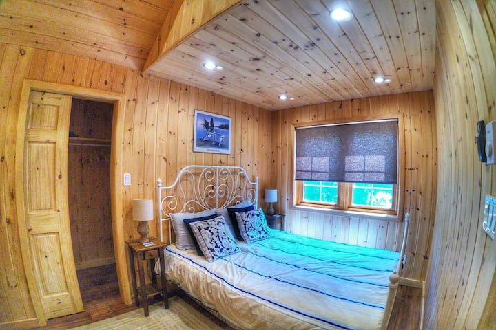 """COTTAGE #2 """"Coach House"""": master bedroom with queen bed and full closet"""
