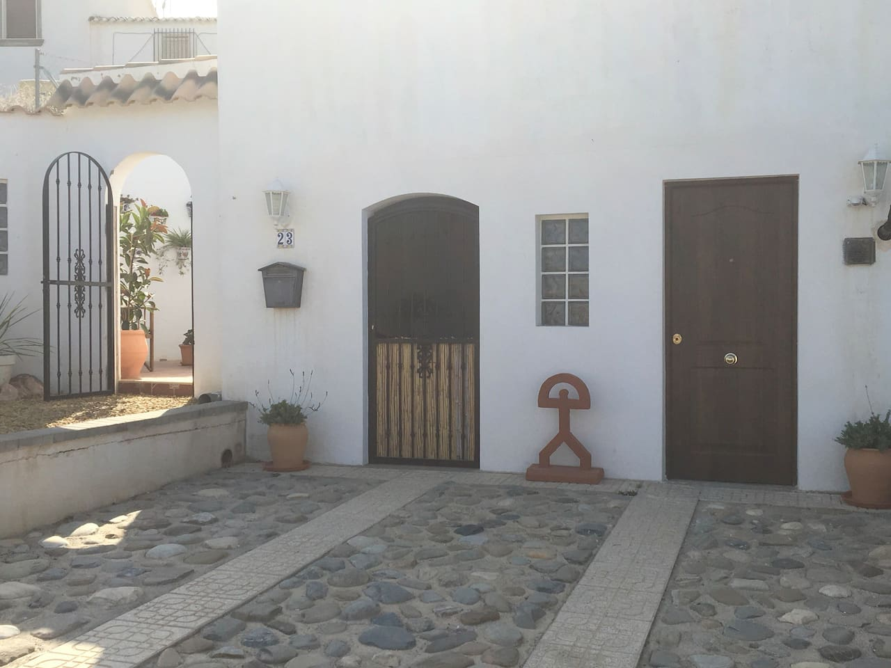 Entrance to the guest suite, gate to patio garden and utility room.