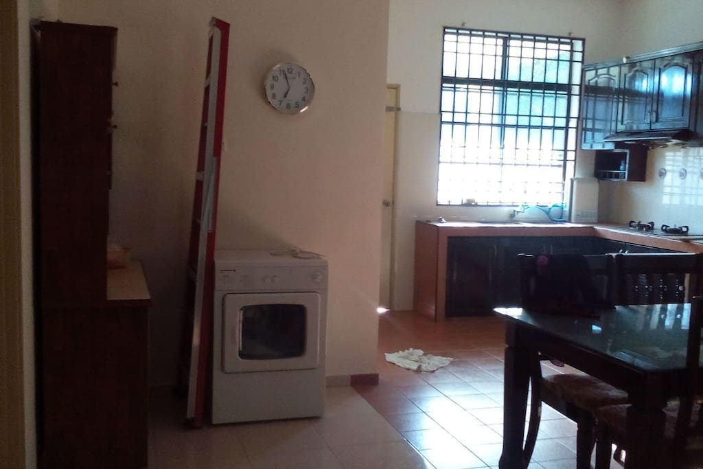 Kitchen come with washing machine, dryer, cooking place & dining table