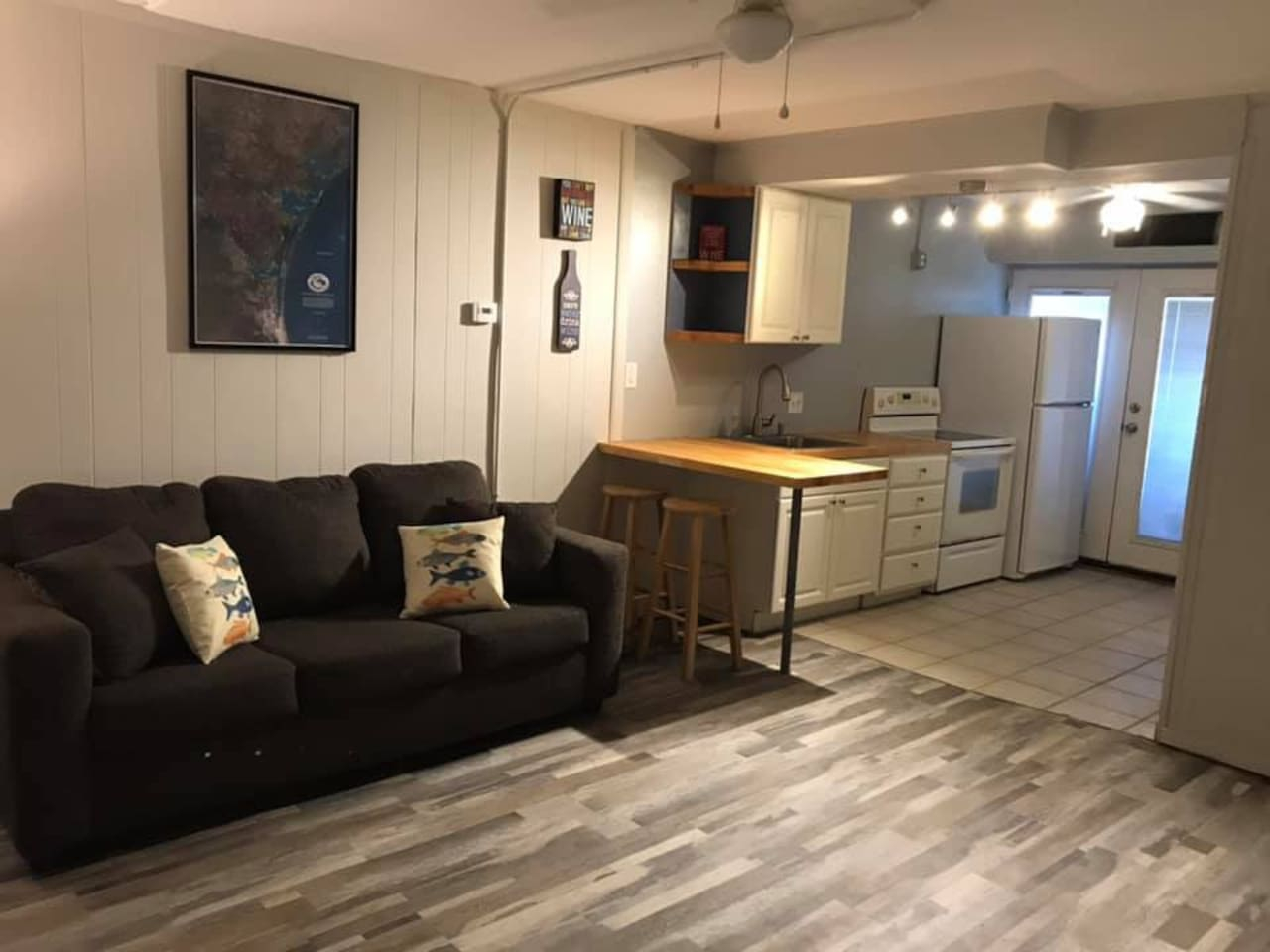 Open floor plan with a sleeper sofa and a queen size bed
