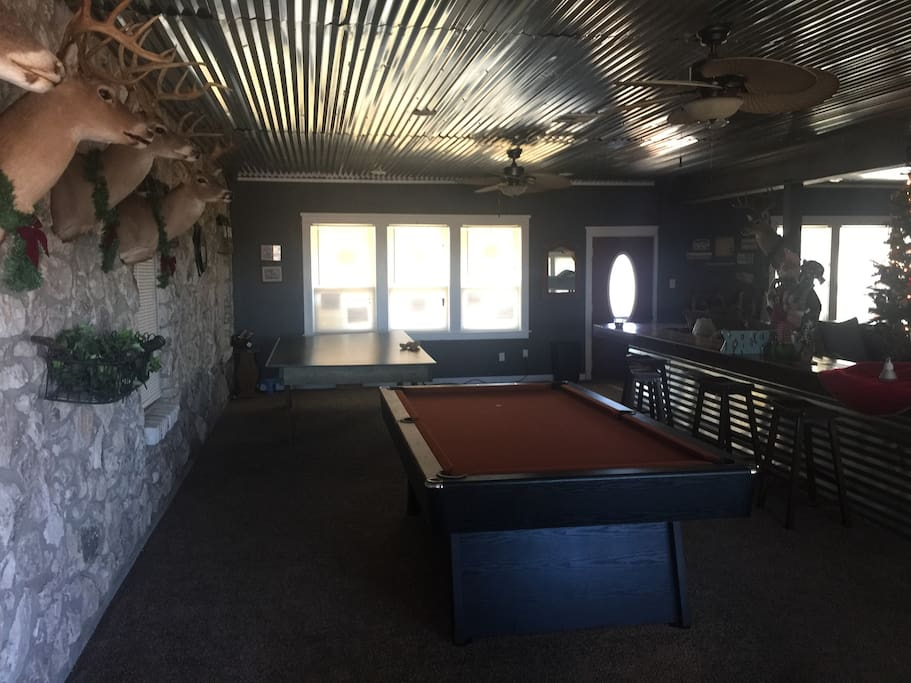 Game room pool table,ping pong, bar area,