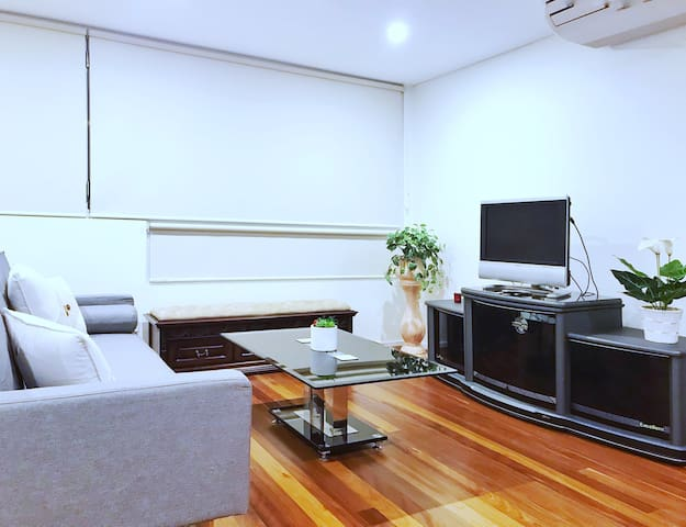 Three seater sofa, TV with Apple TV which connect you to most of popular programs.