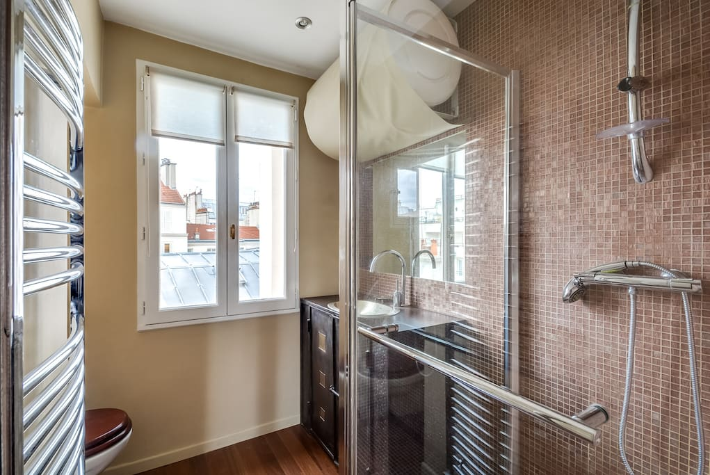 The luxurious bathroom with golden bisazza mosaic and a king size shower