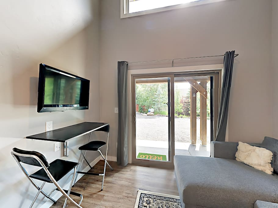 Enjoy the flat screen TV in the living room