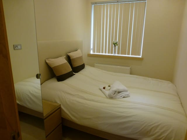 Bedroom 3 with double bed and single wardrobe.