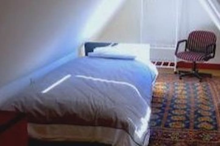The other single bed area in Loft suite that can be curtained off for privacy