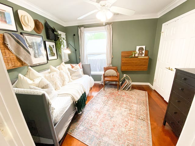 Newly-renovated guest room with a daybed and rolling (raisable) trundle bed.  Use as two twin beds or combine into a King!