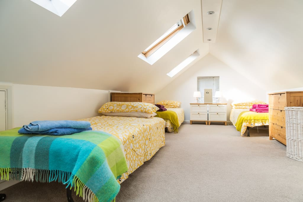 The large attic bedroom for 2 or 3  adults and a small child.