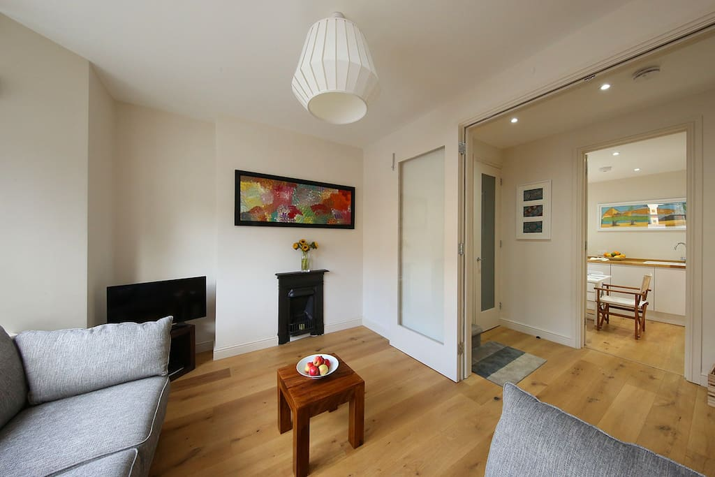 lounge open plan to hall and kitchen