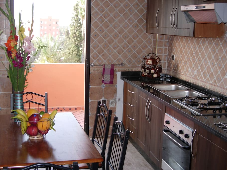 kitchen with door to private terrace