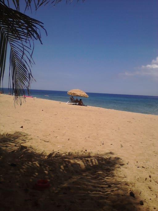 Sandy beach. Restaurants and Bars.