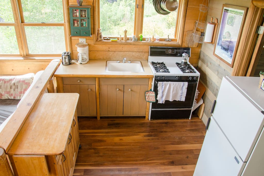 full kitchen with gourmet cooking utensils and gas stove