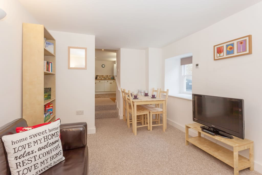 The living room is fully equipped with a large flat screen television, Freeview, books, DVDs and games.