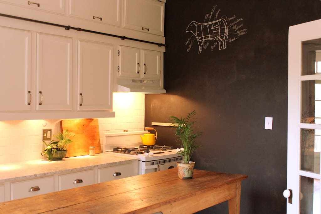 gas stove/oven, chalkboard wall & antique harvest work island