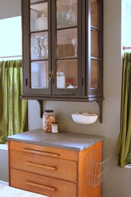 custom cabinet made from salvaged windows and old pine, slate counter and old shop cabinet