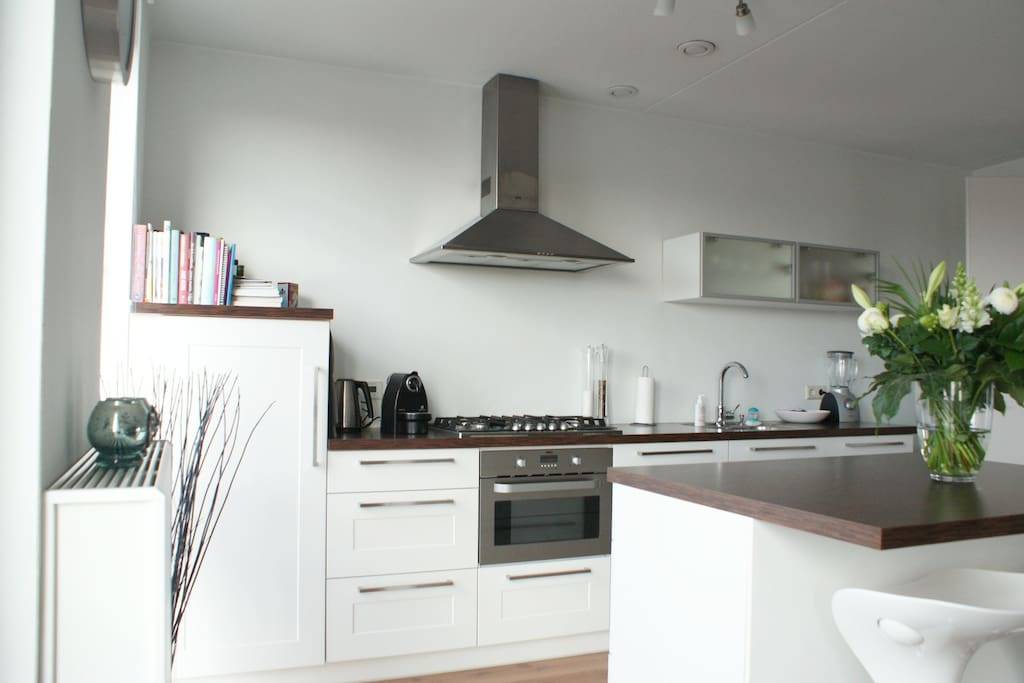 Kitchen and extension with bar stools