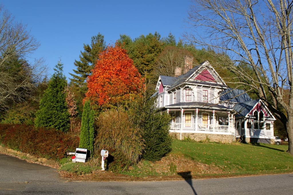 Late Fall of 2012, with the parking lot in the front to the left & Jr Pate road to the right.  That sugar maple is spectacular, and blooms in late fall.  Everything grows so fast here.  You'll notice much more robust landscaping when you pull up.  I do my best to keep it at bay :)