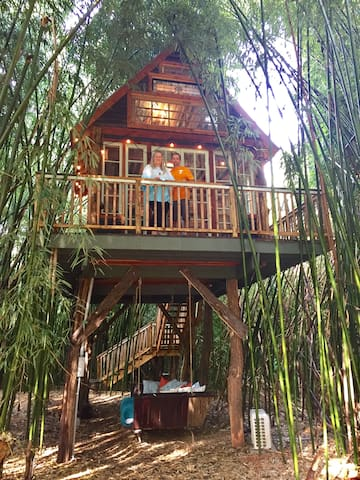 Guests getting a photo taken in the treehouse