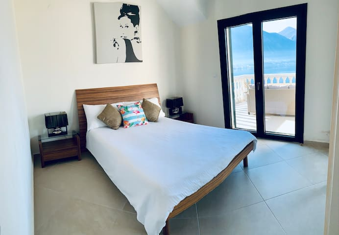 Bedroom 1 (opens up onto terrace)