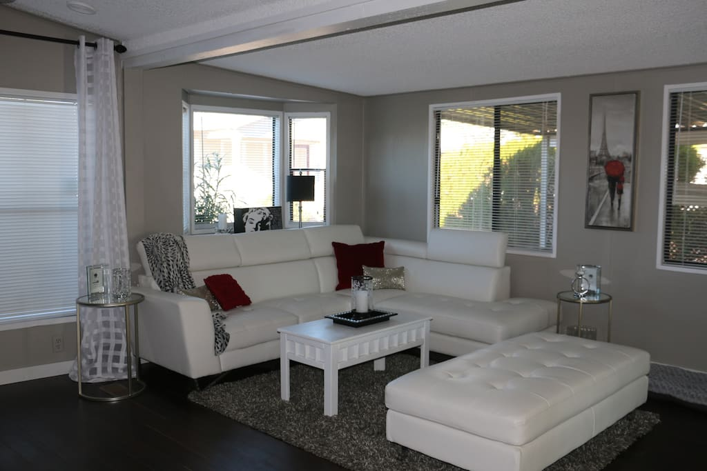 Living area.  White leather sectional couch with ottoman - perfect for entertaining in style!