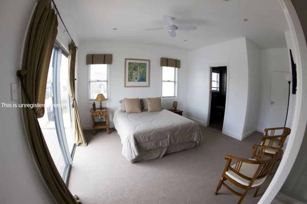 Guest bedroom with adjoining balcony.