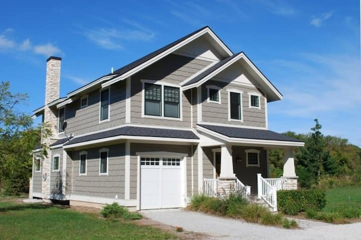Daydreamer - A large luxury vacation home with fireplaces and seasonal pool access, near South Haven beaches!