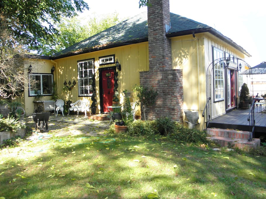 Tucked away under the trees; main front entrance