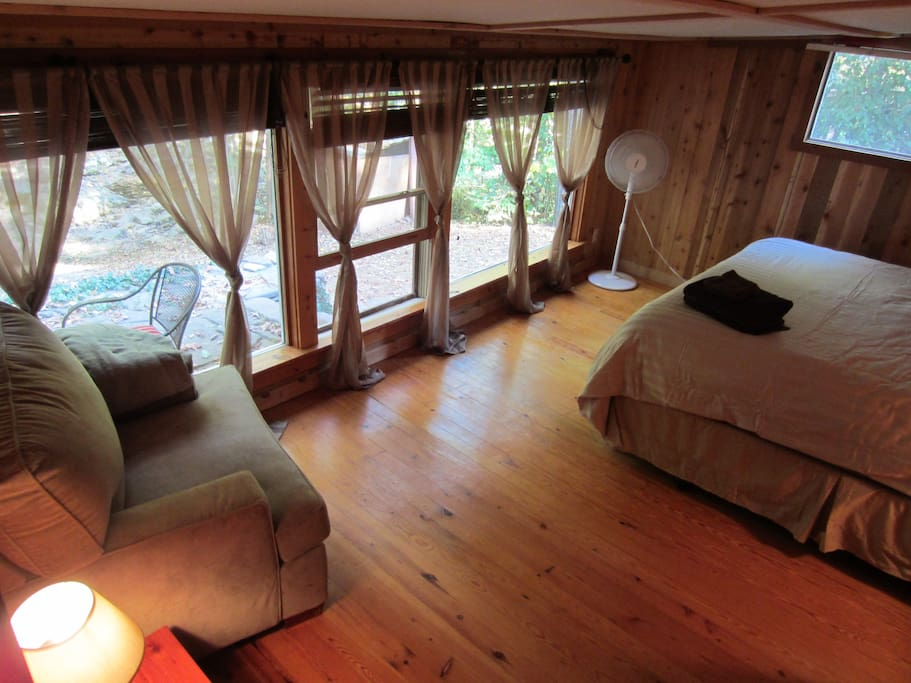 Master bedroom with kind size bed. Looks out onto the creek.