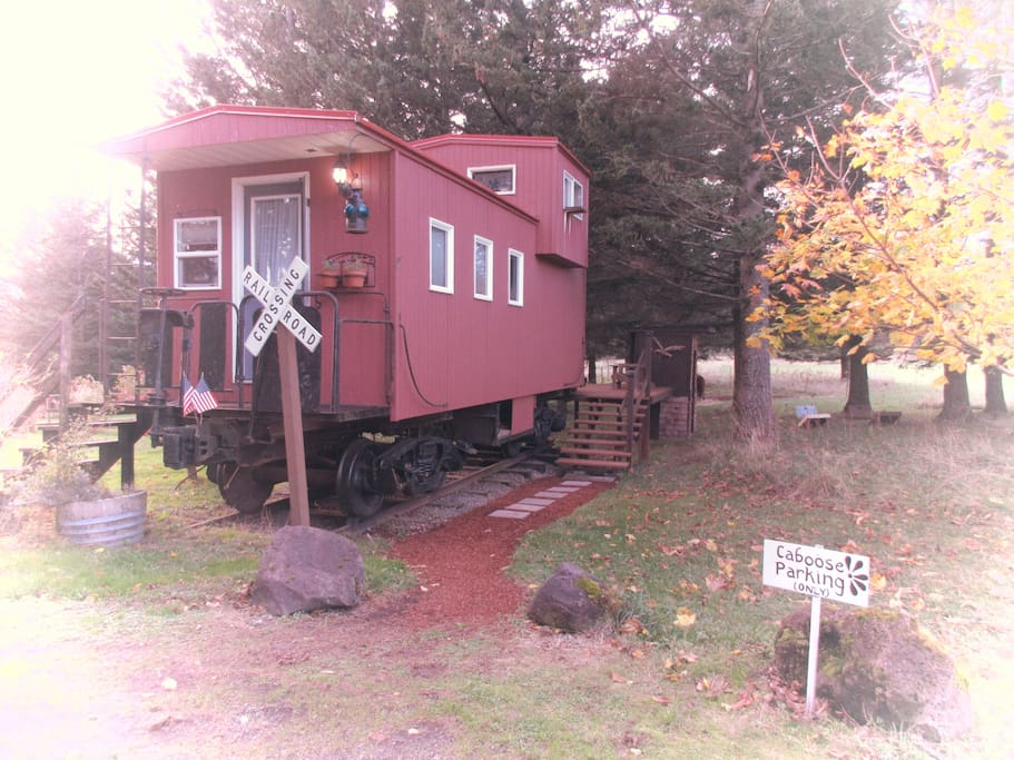 Front of caboose, parking spot and path to entrance (in back)