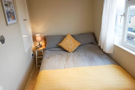 Double bed with private living room on top floor