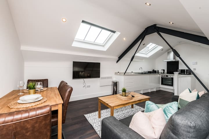 Open-plan spacious living area and kitchen with dishwasher & washing machine.