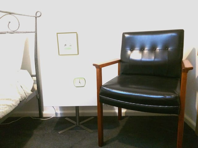 A vintage chair completes each bedroom's furniture. This one was restored recently.
