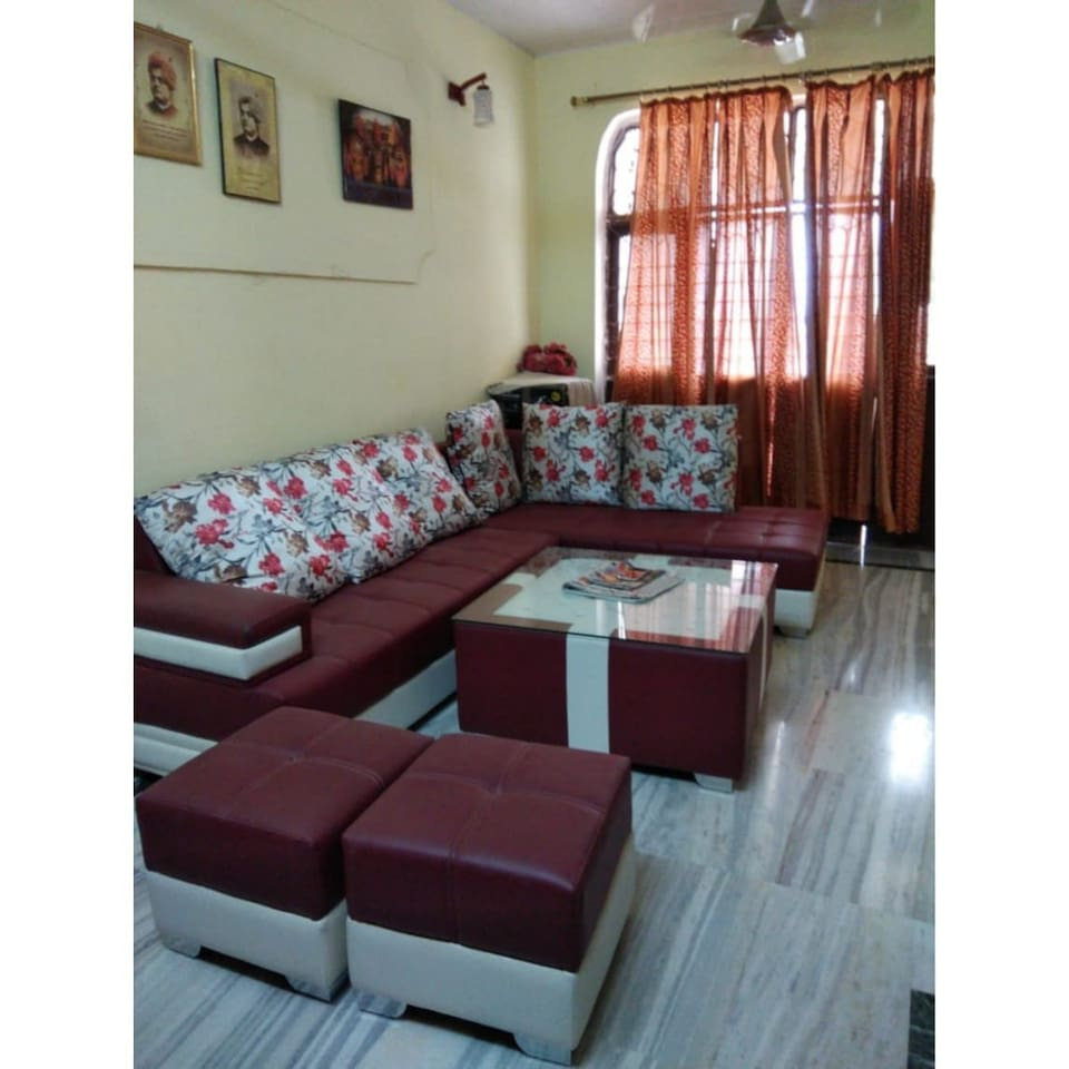 Shared drawing space with sofa for your comfy stay