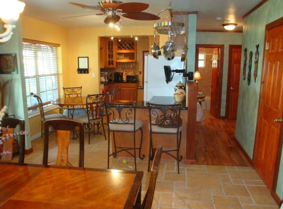 The beautifully furnished open kitchen and dining area can seat up to twelve.