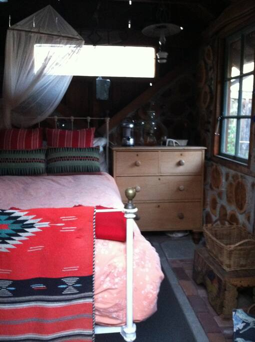 Cozy cabin interior with extra-long twin bed.