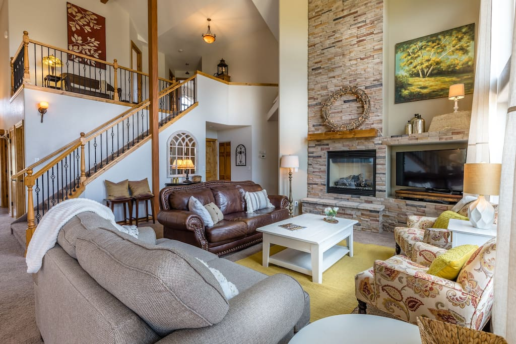 Living room in open the open concept main floor accommodates family and friends nicely
