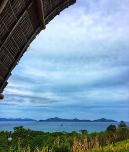 vue grand hilltop,El nido bay view native huts
