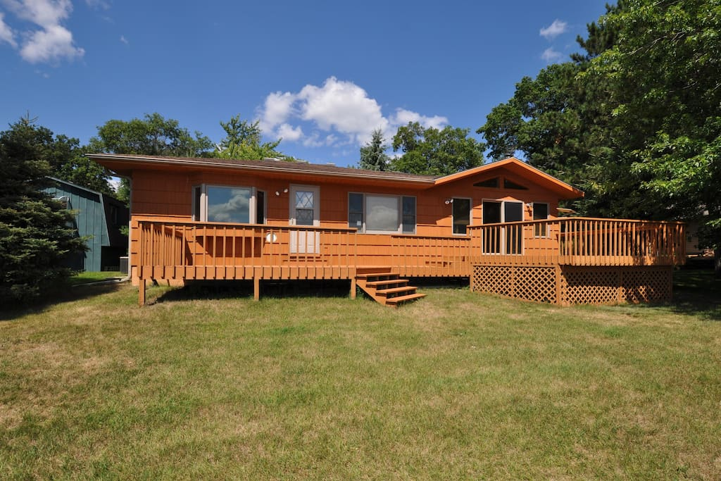 The home boasts a spacious deck facing the lake.