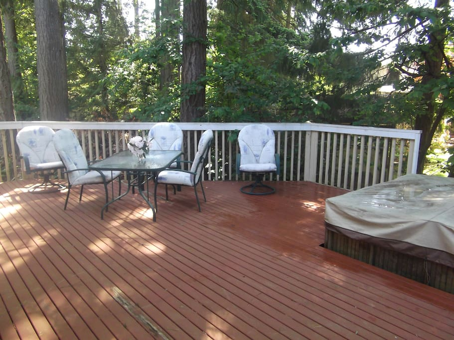 Back deck with hot tub and table