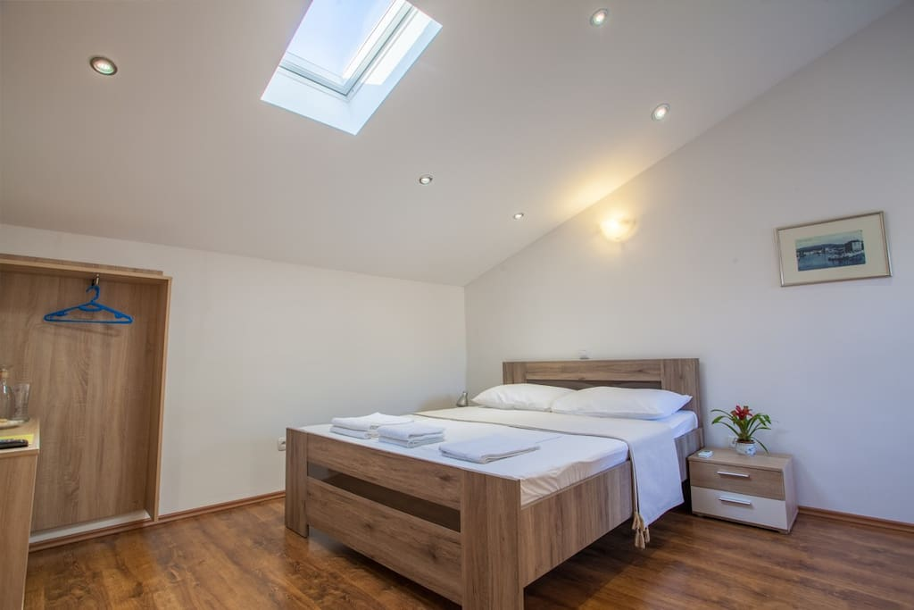 Room is furnished with a queen sized, hand made bed, with a skylight above for lots of natural light.