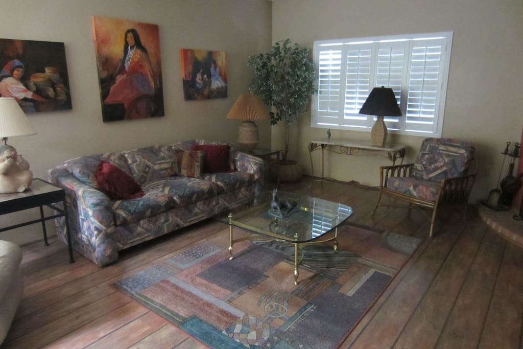 Living Room with hardwood flooring and plantation shutters
