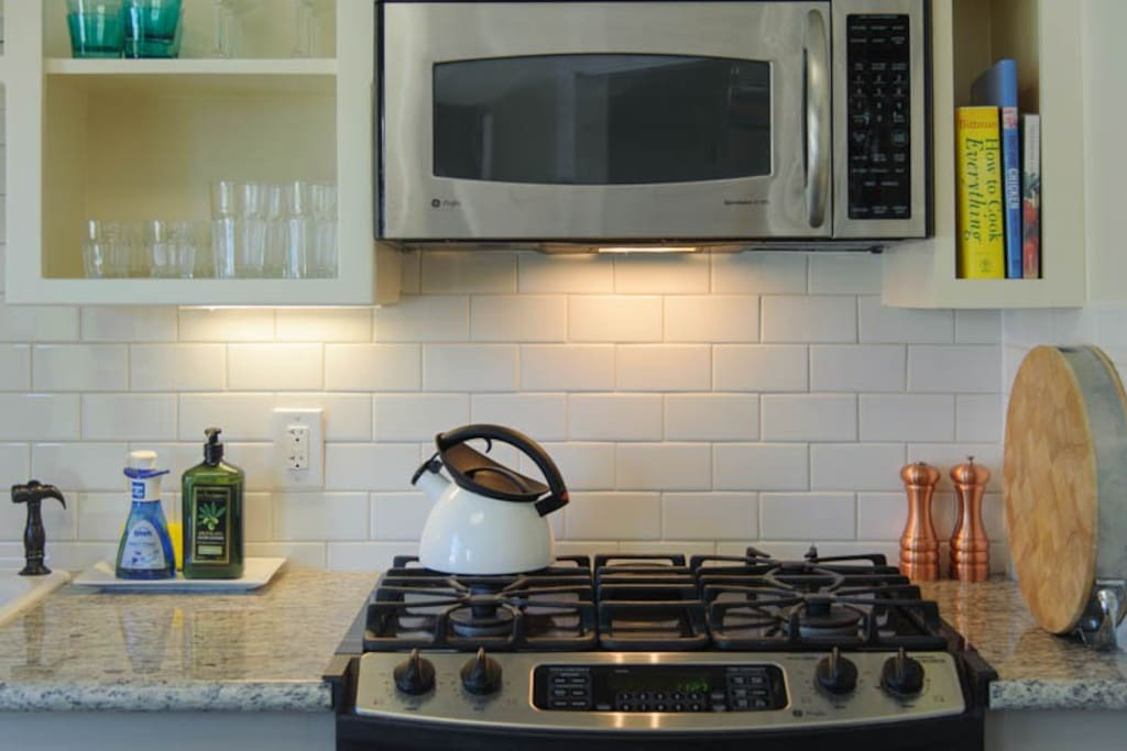 amazing gas stove + lots of chefs tools make this the perfect kitchen--with a couple of cookbooks to help you out!
