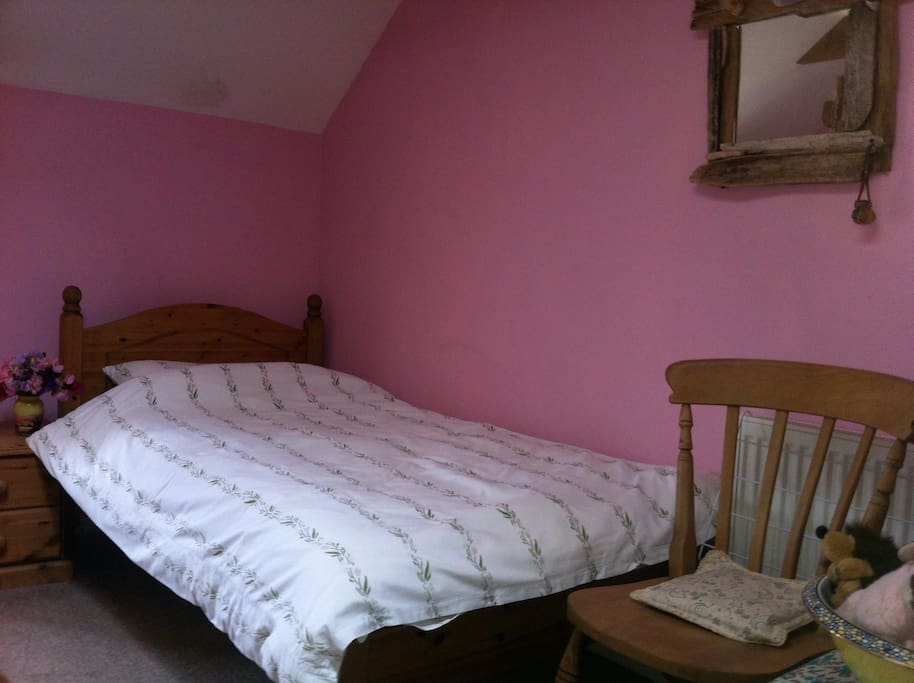 A great real single or twin bedded room with a view over countryside