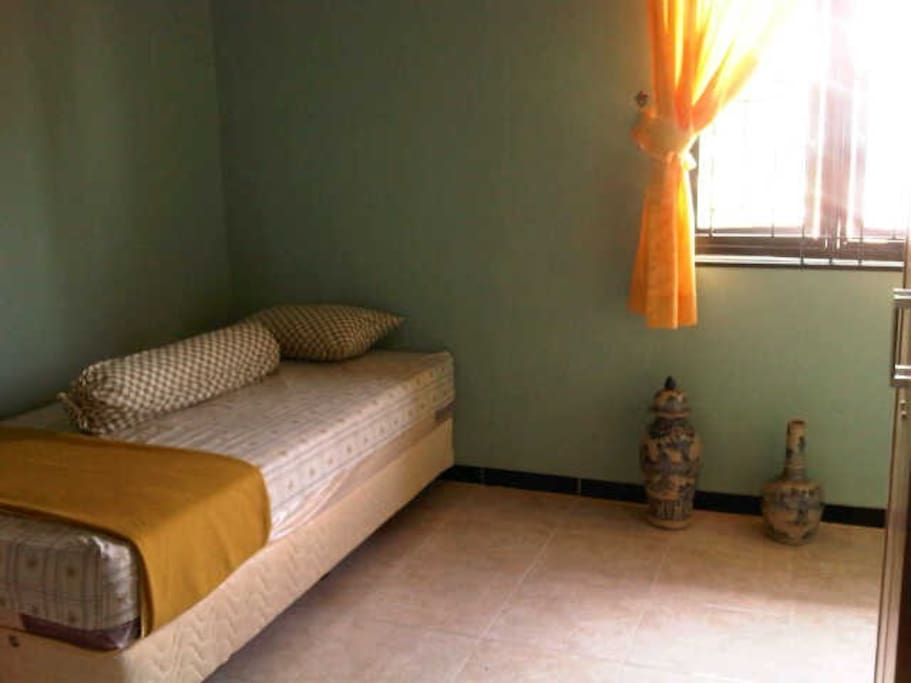 Air conditioned room, with individual bathroom inside.
