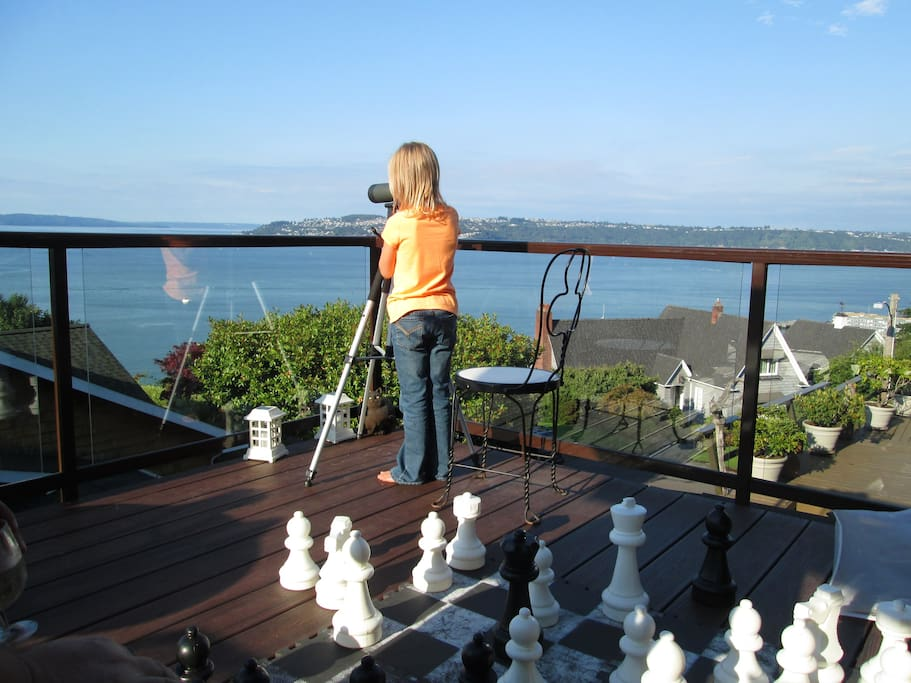 Looking through the spotting scope. Large chess set on the water side deck